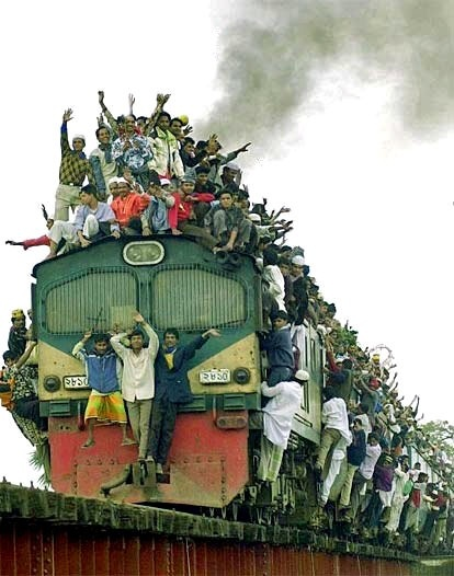 On this pin you see a train in India. As you can see, the train is very overcrowded. Travelers can choose from up to eight classes of travel.  In the vicinity of large cities like Bombay, there is a ninth class of travel which is on the outside of the train, which is free. The railway network in India is one of the biggest in the world. Circa 23 million people take the train daily.