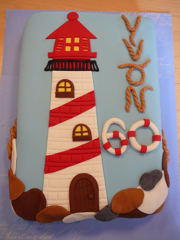 Lighthouse - Yvon, 60 years old loves the lighthouses and the sea. I really enjoyed making this cake with all the sea details. This is chocolate cake with chocolate filling and fondant.