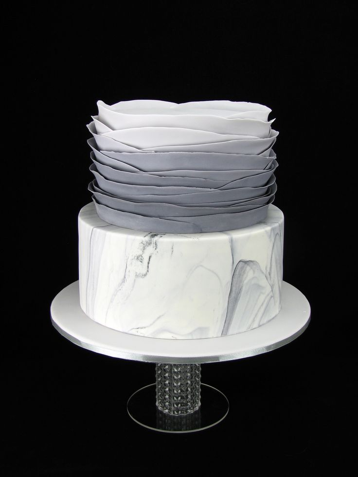 A sophisticated grey ombre and marbled fondant cake for a 21st celebration. The cakes are chocolate mud with chocolate ganache.