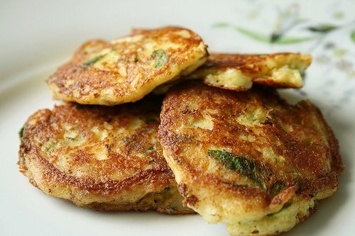 Zucchini Potato Gluten-Free and Vegan Pancakes(latkes)      These pancakes are quick to make, and healthier than the typical greasy latkes. Plus, you're actually getting a good serving of vegetables and protein!     1 cup finely shredded zucchini  1 cup finely shredded potatoes  1 cup chick peas/garbanzos, mashed with fork  2 tablespoons nutritional yeast  2 cloves garlic, minced  3/4 teaspoon sea salt  pinch or two freshly grated black pepper