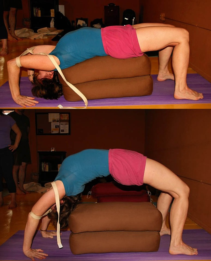 Iyengar Yoga – use of strap and bolsters to help lift up into Urdhva Dhanurasana at a Texas Workshop