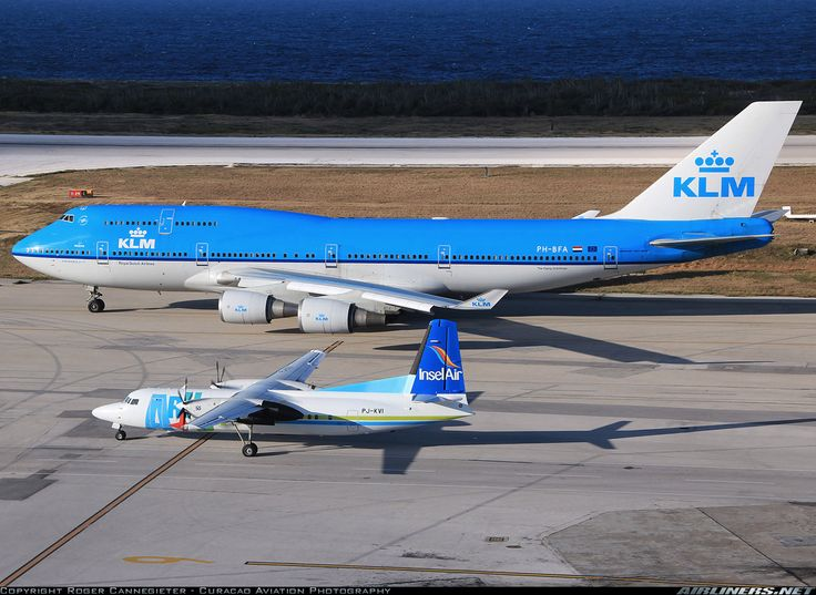 """This is my first """"size comparison"""" photo. The photo is also great as it depicts the national airline of the Netherlands (KLM) and a piece of great Dutch engineering, the Fokker 50. This Fokker 50 also used to be in the KLM fleet a few years ago.  Insel Air Aruba Fokker 50  Willemstad / Curacao - Hato (CUR / TNCC) Curacao, February 7, 2014"""