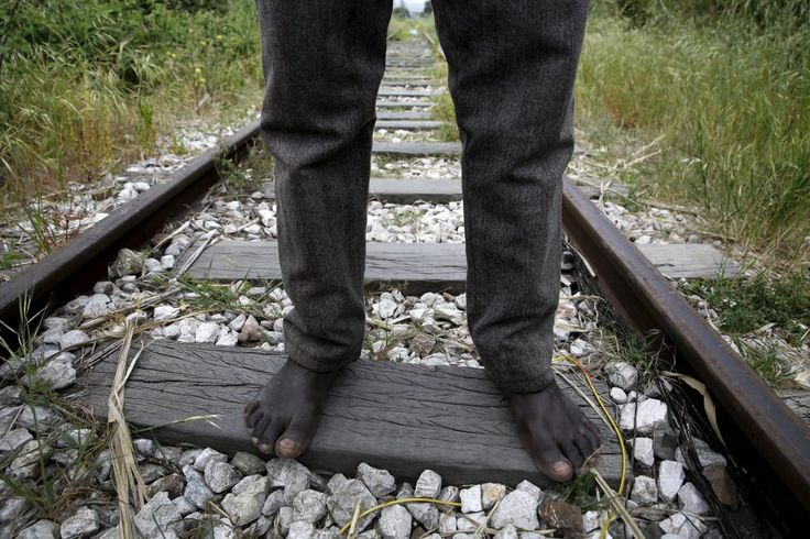 26-year-old Azam from South Sudan stands on rail tracks after failing to flee to Italy in Patras, Greece April 28, 2015. Afghan, Iranian and Sudanese immigrants, living precariously in abandoned factories in Patras, southwest Greece, try to stow away on nearby ferries to Italy as they seek a better life in Europe beyond crisis-hit Greece. Shocked after as many as 900 people drowned last month in the worst Mediterranean shipwreck in...