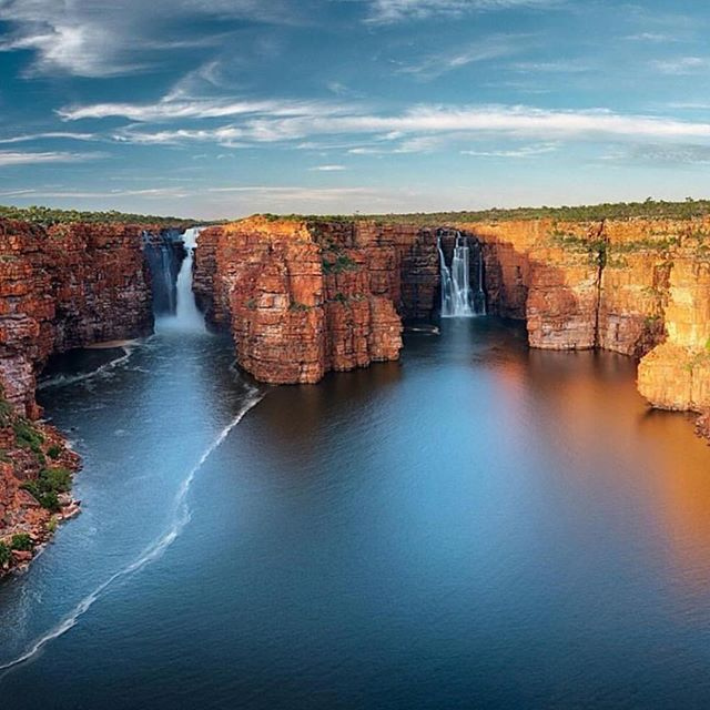 The almighty King George Falls captured by @bjk_photo at sunrise. Tag someone you would love to explore the Kimberley Coast with. #thekimberleyaustralia