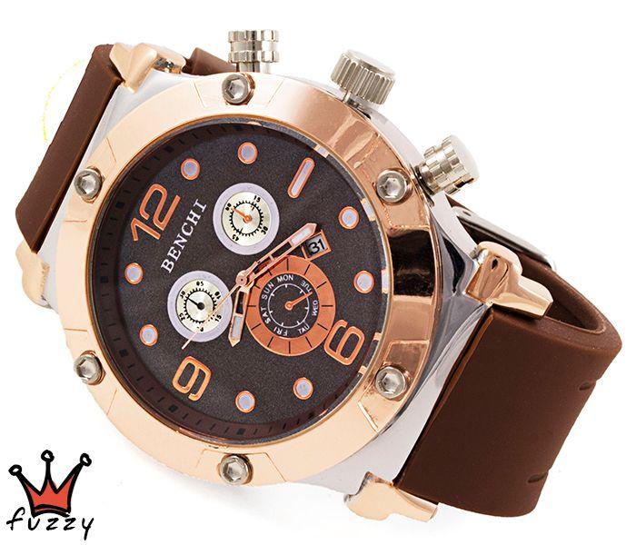 Γυναικείο ρολόι, με κάσα σε ροζ χρυσό και ασημί και καφέ χρώμα στο εσωτερικό του.  Λουράκι σε καφέ χρώμα από σιλικόνη. Διάμετρος καντράν 47 mm