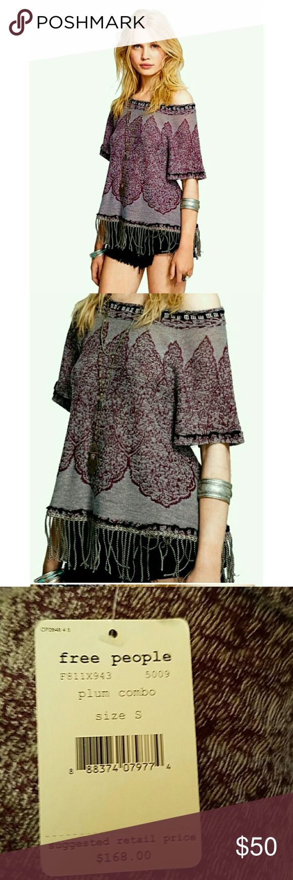 "NWT Free People Kilm Swing Fringe Top Small An exotic knit design lends world-market appeal to a slouchy elbow-sleeve top tailored with a wide, shoulders baring neckline and finished with loads of swings tassels at the hem. 24"" length.  Rayon/wool blend  Plumb combo.  Retail price $168.  Size small. Free People Tops"