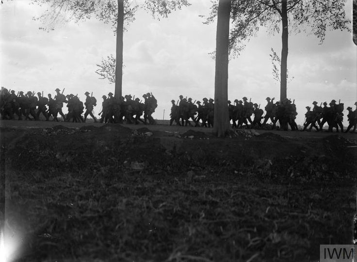 Relieving Battalion, 4th Battalion, Dorset Regiment, marching up to the line in the evening, on a road near Ypres, 5th September 1917.