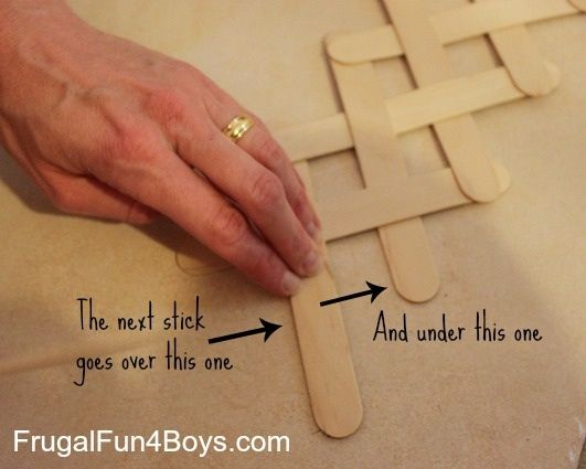 http://frugalfun4boys.com/2013/05/13/build-a-chain-reaction-with-popsicle-or-craft-sticks/