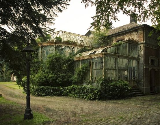 abandoned home with a conservatory- how beautiful and sad at the same time.