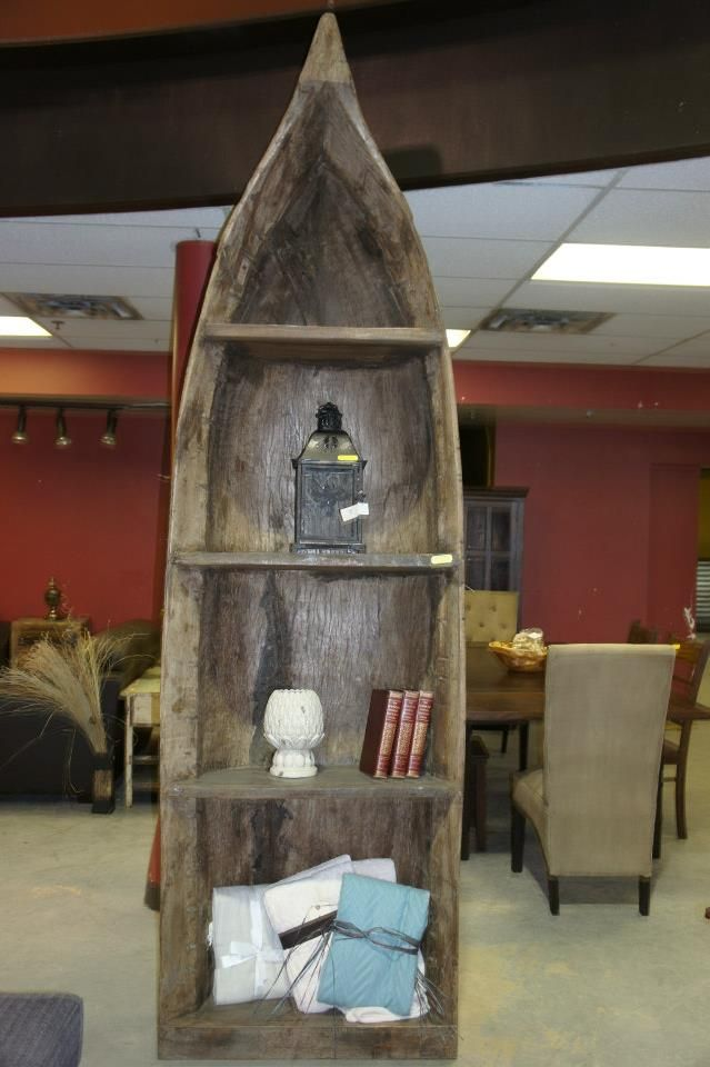 Rustic canoe bookcase! Like us on Facebook and receive a $25 coupon: www.facebook.com/showhomefurniture Or visit our website: www.showhomefurnituresale.com