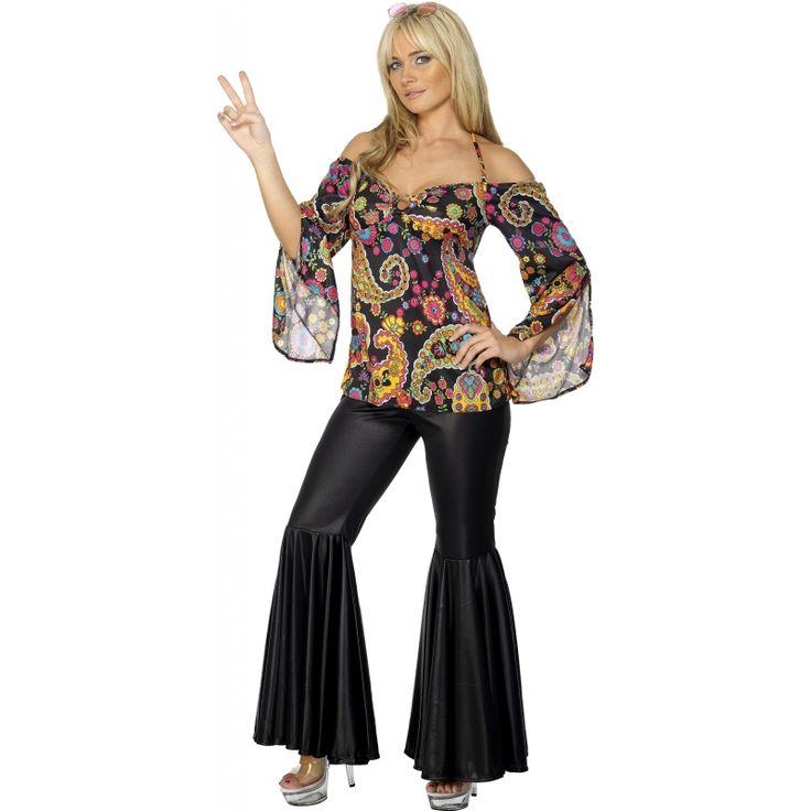 Hippie outfit voor dames  Stoere hippie dames kleding. Deze hippie dames kleding bevat een donkere broek die rond het bovenbeen strak aanloopt en op het onderbeen uitloopt. Boven de broek komt een top die over de schouders heen zit. Het is een zwarte top met geel groene en blauwe print.  EUR 39.95  Meer informatie