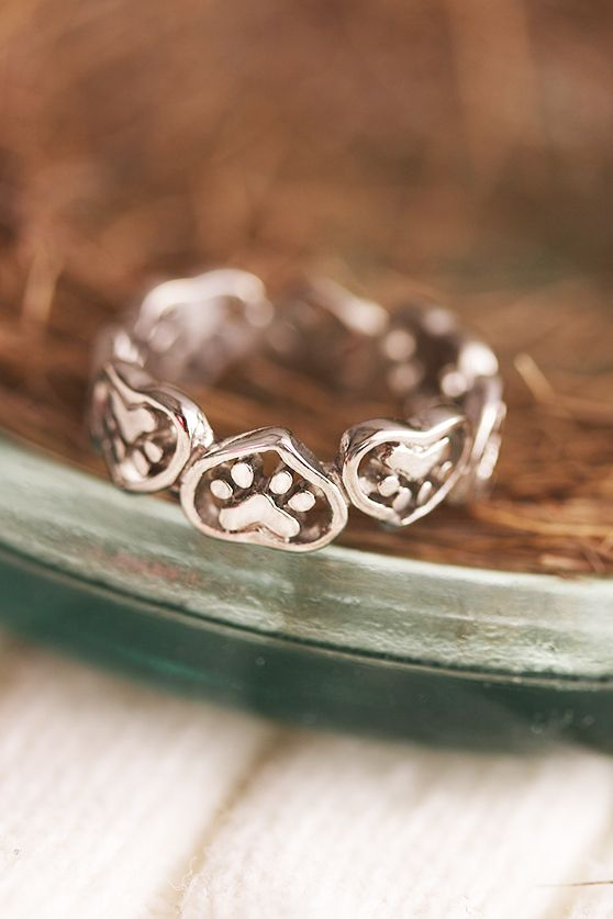Patterned in paw-filled hearts, our stainless steel ring is a true testament to the adoration you hold for your furry one.