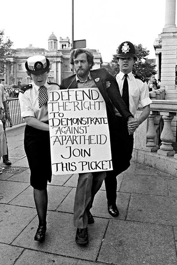 Controversy: Police haul Mr Corbyn away as he supports a 1984 anti-apartheid protest