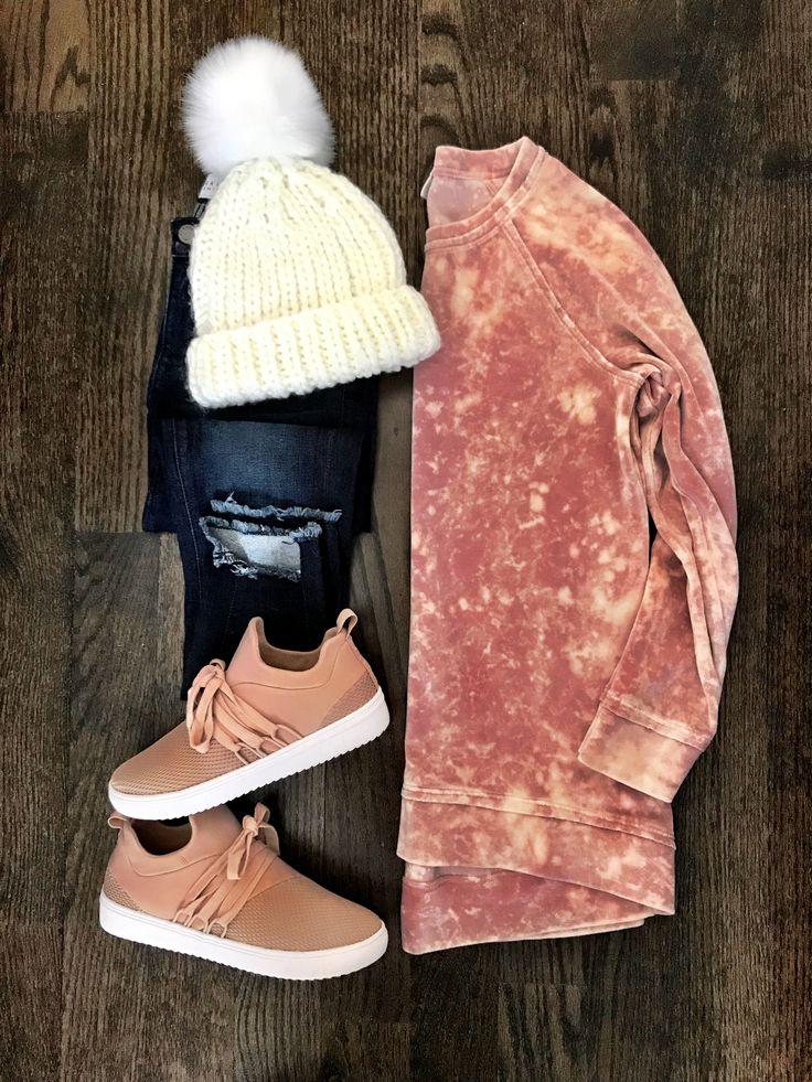 IG: @mrscasual | White pom pom beanie, blush sweatshirt, jeans, and blush sneakers