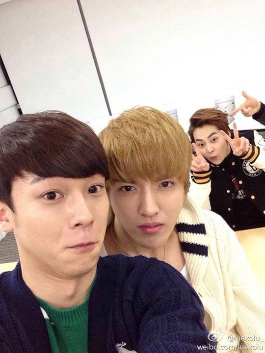 Chen making a derp face, Kris looking serious, and Xiumin being his adorable little self in the back.