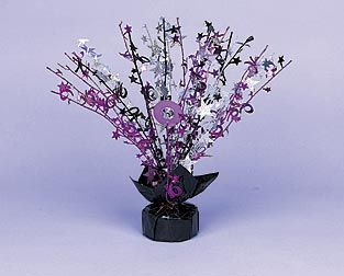 Our Sweet 16 Sparkle Centerpiece features hot pink, black and silver sprays. Use the 18 inch foil Sweet 16 Sparkle Centerpiece to accent your party tables.