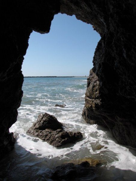 """Sea Cave at Corona Del Mar. """"The sea caves of Corona Del Mar are a great way to beat the heat.  If you want to check out some interesting coastal geology without having to go all the way down to Dana Point, this is a good hike to do.  It is a little trickier than the Dana Point trip, however, so if you don't have a lot of experience climbing over slippery rocks and with beach hiking, definitely make sure you go at low tide..."""""""