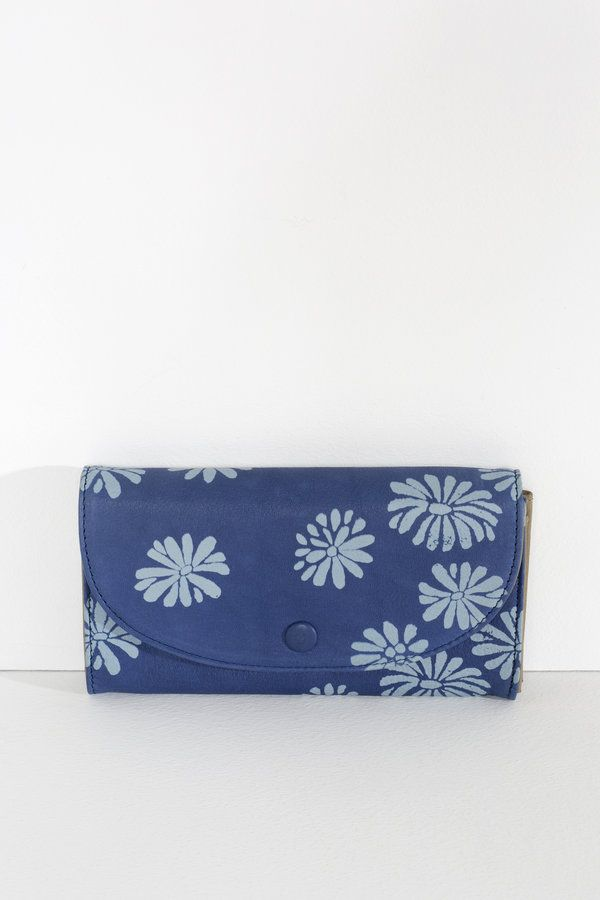 A new wallet shape with structured body and removable coin purse.  removable zip purse for coins structured body twelve card slots two note...