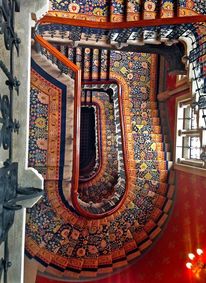 A staircase in the St. Pancras Renaissance London Hotel, from the top looking down.