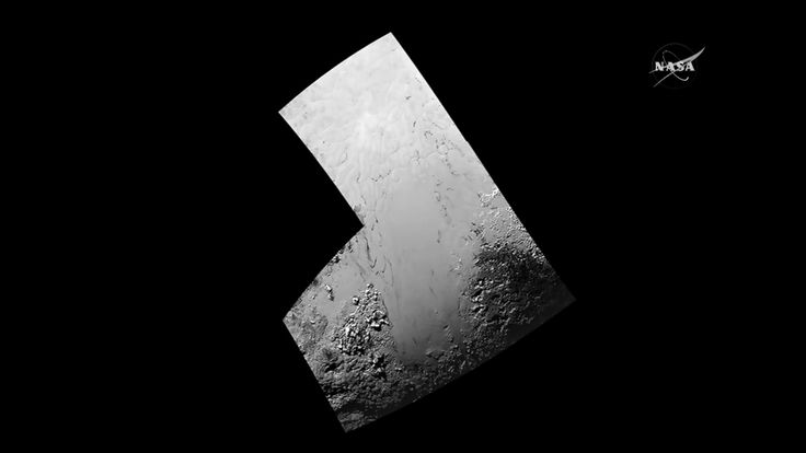 New high-resolution images show Pluto's 'icy, frozen plains'
