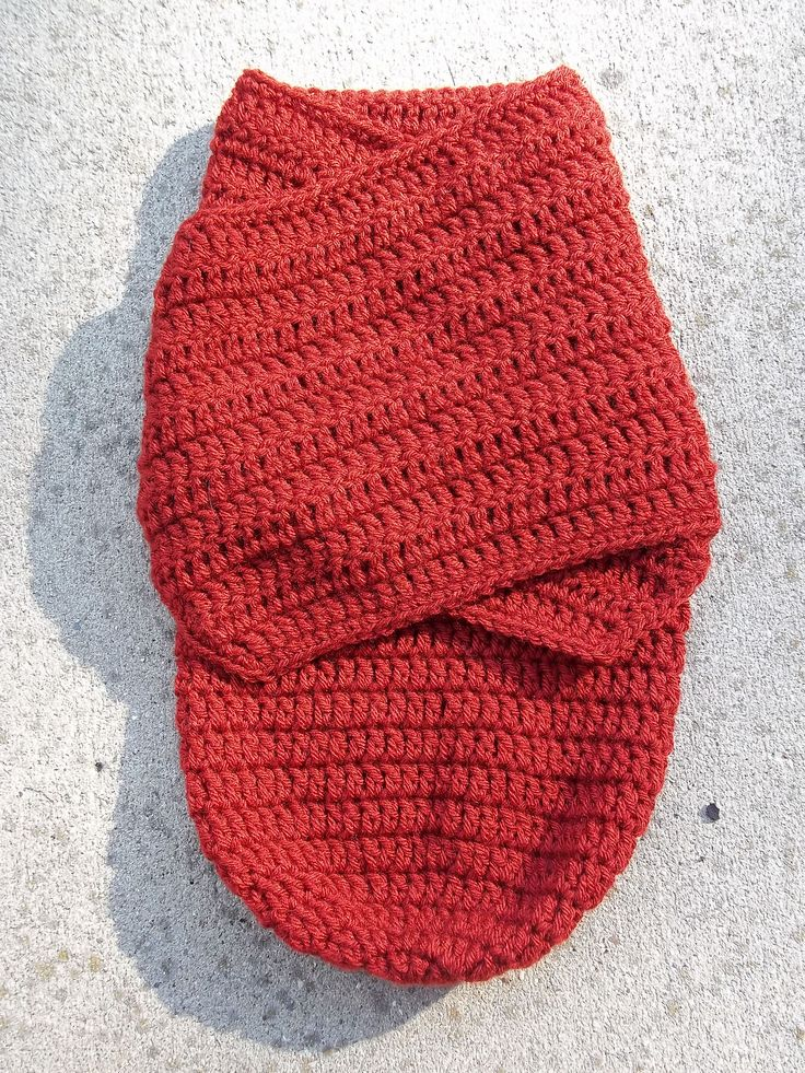 """A #crochetbabycocoonpattern like this one is great to swaddle baby in. Once baby is in the sack you can make it tighter and swaddled with the side """"straps""""."""