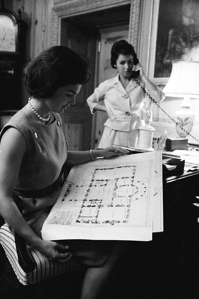 Jackie Kennedy with White House plans