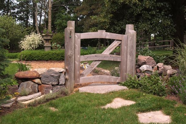 Pathways to Perennials - we hunted for antique beams to re-create this ancient looking farm gate that takes the homeowners and visitors through to the (kitchen) Potager Garden.