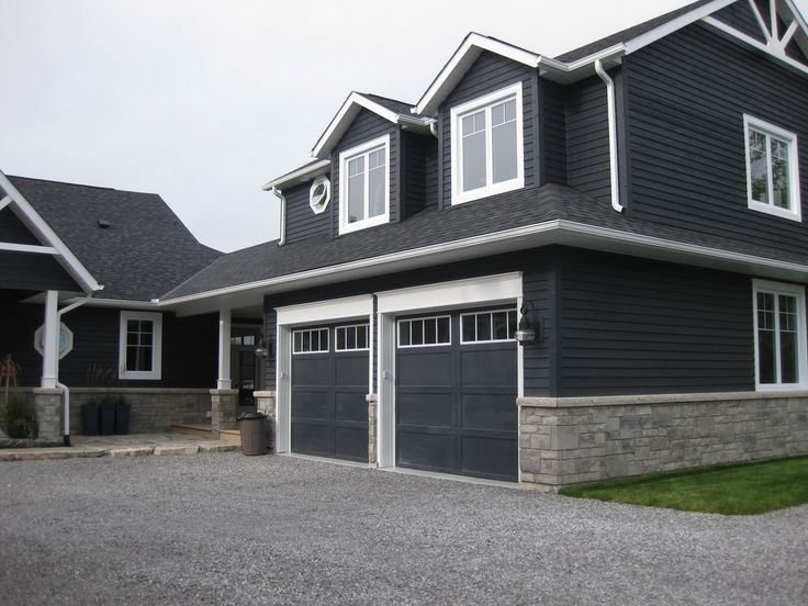 Dark Blue Grey Vinyl Siding On A House With Stone Veneer