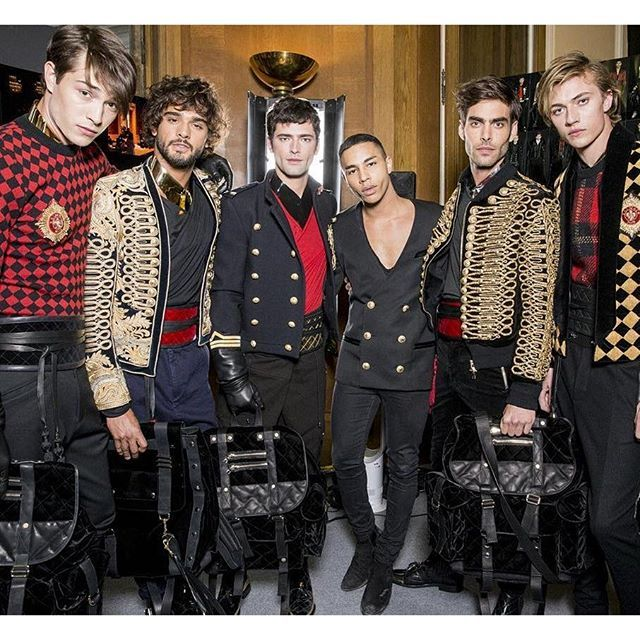 We have Marlon, Sean, and Jon. The one on the far left is another Brasilian, Francisco Lachowski but I don't know the other 2. The clothes do nothing for me, unless it's a costume party