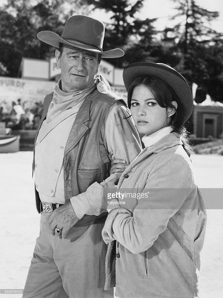 Actors Claudia Cardinale and John Wayne are featured in the Wild West show of the Matt Masters Circus, in a scene from the film 'Circus World', Spain, December 10th 1963.