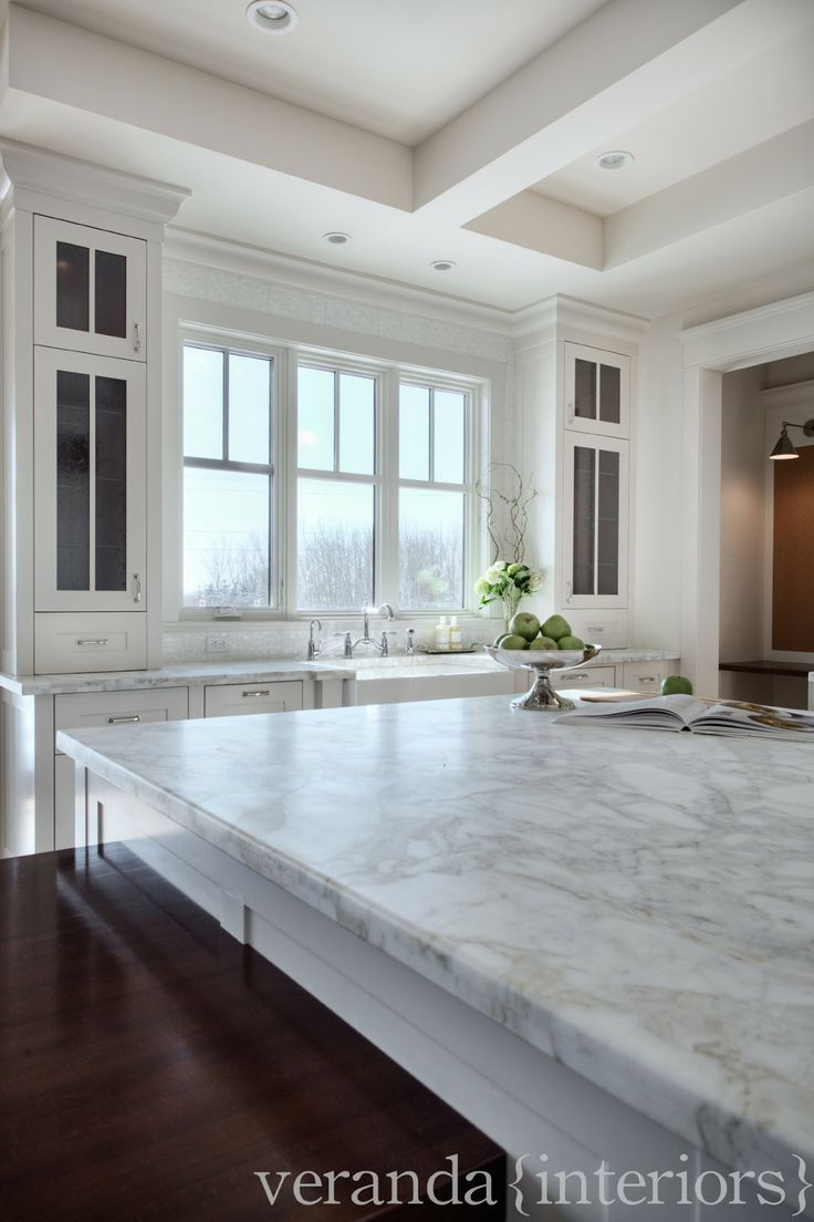 Another cabinet option for flanking sinks where reaches to counter instead of floats. Also very nice calacutta gold marble in leathered finish.
