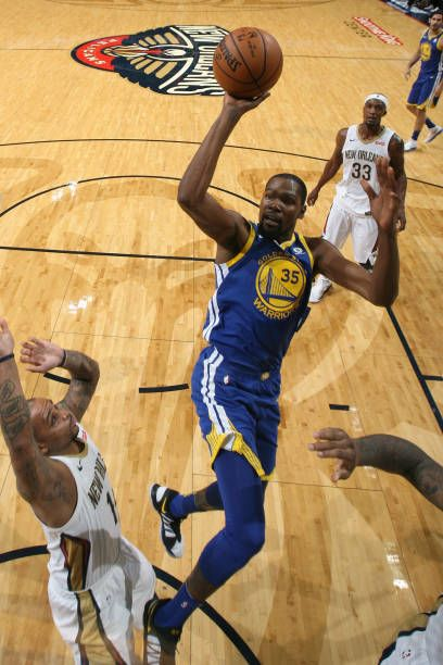 Kevin Durant of the Golden State Warriors shoots the ball against the New Orleans Pelicans on December 4 2017 at Smoothie King Center in New Orleans...
