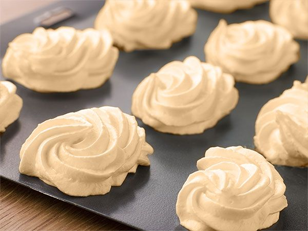 Suspiros, or Meringue Kisses, are a traditional Portuguese dessert typically served during weddings or during other holiday celebrations like Christmas.