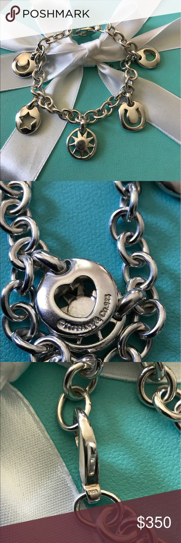 """Retired Tiffany & Co. Charm Bracelet Preloved and gently used Authentic Tiffany charm bracelet with heart ❤️ , horseshoe, sun ☀️ , star ⭐️ and moon 🌙 cutouts. This is a very unique and cute bracelet. There are signs of minor wear from daily use. Please look at the photos closely. Make me an offer! Comes with a pouch and a box. Size 7.5"""" Tiffany & Co. Jewelry Bracelets"""
