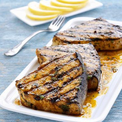 How to Grill Fish - Grilling Fish on a Gas Grill - Delish.com