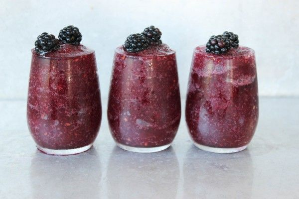 Mix vodka, blackberries, orange juice, red wine, agave + ice together to make this Blackberry Wine Slushie frozen cocktail recipe for the summer.