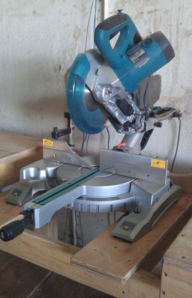 """10"""" Makita compound mitre saw with laser guide."""