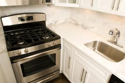 How to Clean an Oven With White Vinegar & Baking Soda spray hove with hot water, sprinkle baking soda over oven,close door let harden, spray vinegar through out oven, scrub with Brillo or other clean pad, wipe,