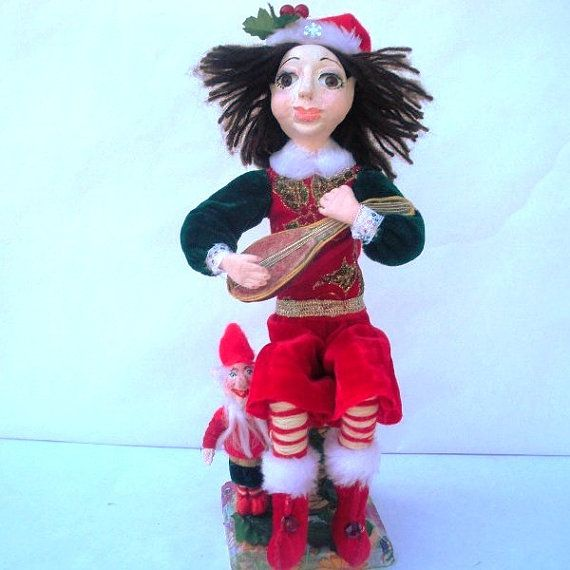 Christmas Elf doll sitting playing banjo with the by irinaalek