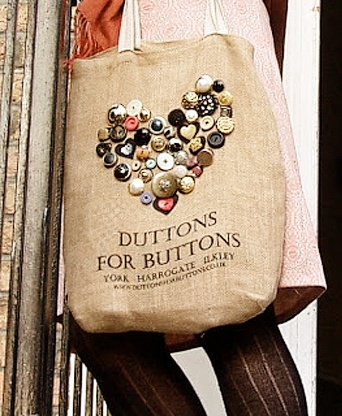 When you visit Duttons for Buttons you can purchase a hessian bag imprinted with shapes of buttons in a heart.  It's tradition to sew real buttons onto the bag to make it uniquely yours.  Their website even has photographs of decorated bags from customers.