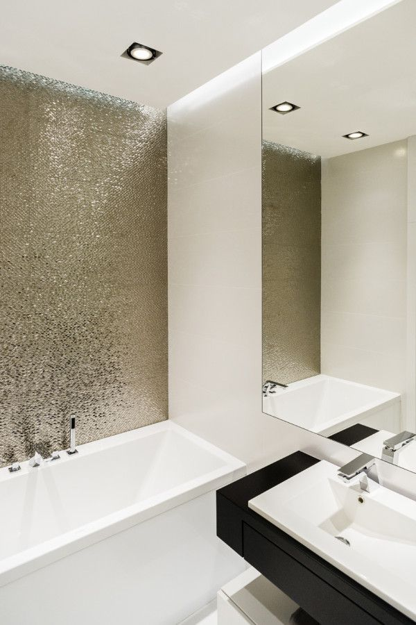 This Apartment Will Inspire You To Go Bold With Your Decor #refinery29 http://www.refinery29.com/design-milk/32#slide-11 Metallic tiles play a key role in this bathroom's decor scheme.
