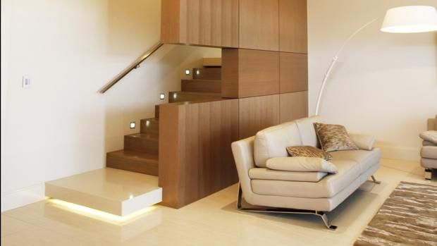 Make a feature of your staircase with an architectural wall and lighting...