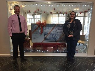 """We want to thank everyone who attended The Pavilions Holiday Party last night!  Congratulations to Victoria who was randomly selected to receive the 55"""" Smart TV! She is shown here with Pavilions Leasing Consultant Patrick!     Happy Holidays!     #WinterSolstice #PavilionsLife"""