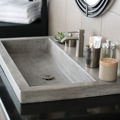 Features:  -Material: Stone.  -40% Lighter than traditional concrete.  -Scratch, crack and stain resistant.  Installation Type: -Self rimming sink.  Style (Old): -Contemporary.  Sink Shape: -Rectangul