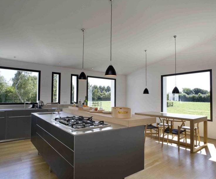 View outside from kitchen; kitchen island with black pendant lighting above, © Paul Tierney