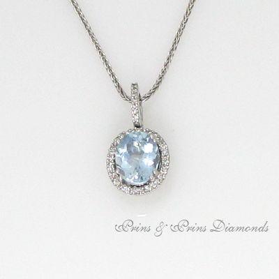 Oval Aquamarine pendant set with a diamond halo in white gold