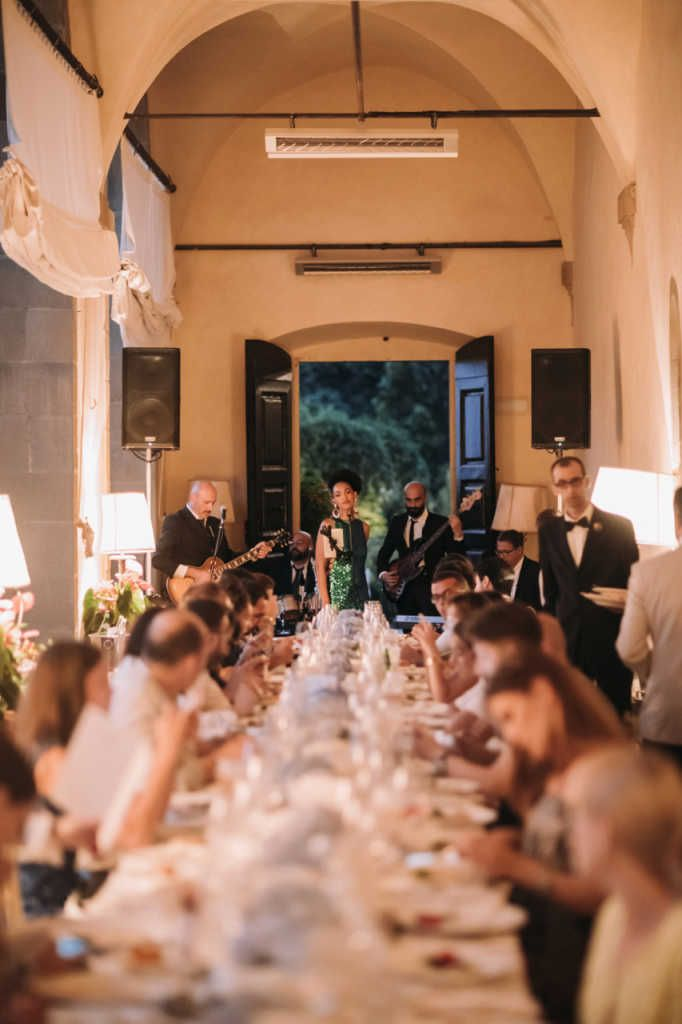 Party band performing during a wedding dinner at Villa San Michele, Florence, Italy.