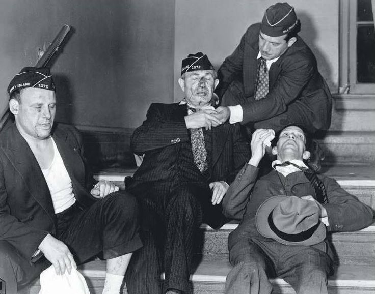 Bloodied members of the American Legion recover following a fight with members of the German American Bund (American Nazi Party) in 1938.