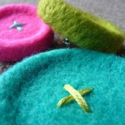 Merino wool needle felted button brooches. I can imagine this on Amy Swenson's Better Bucket hat.