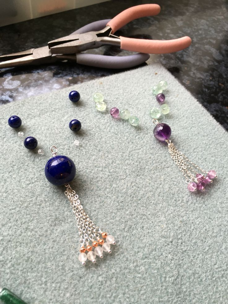 Close up of a Lapis tassel and an Aquamarine and Amethyst tassel #design #unique #create #make #GGJewellery